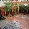 natural flagstone patio with pergola and waterfeature in minneapolis
