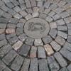 permeable historic granite cobble patio with bluestone in minneapolis